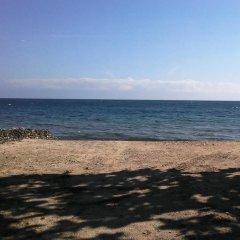 Отель Serenity Beach Cottages пляж