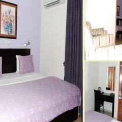Отель Neo Courts Нигерия, Энугу - отзывы, цены и фото номеров - забронировать отель Neo Courts онлайн комната для гостей фото 2