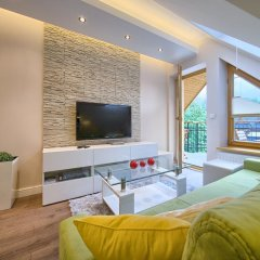 Апартаменты VisitZakopane Island Apartments комната для гостей фото 4