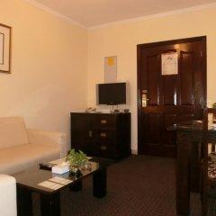 Al Muraqabat Plaza Hotel Apartments комната для гостей