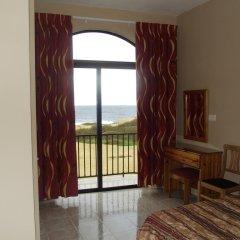 Апартаменты Sunset Seaview Apartments комната для гостей фото 2