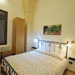 Отель Delfino Suite Лечче комната для гостей фото 2