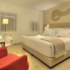 Отель NH Collection Porto Batalha 4* Улучшенный номер с различными типами кроватей фото 7