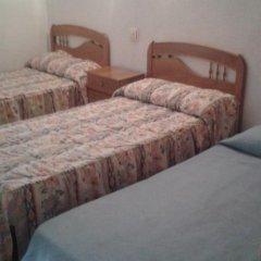 Отель Hostal Pineda Стандартный номер с 2 отдельными кроватями фото 2