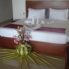 Отель Whispering Palms Hotel Шри-Ланка, Бентота - отзывы, цены и фото номеров - забронировать отель Whispering Palms Hotel онлайн комната для гостей фото 3