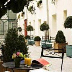 Отель Suites Unic Renoir Saint-Germain Франция, Париж - отзывы, цены и фото номеров - забронировать отель Suites Unic Renoir Saint-Germain онлайн