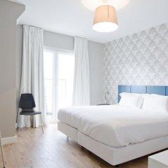 Отель Gloria Design Suites комната для гостей