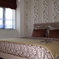 Отель Mindaugo Apartment 23A Литва, Вильнюс - отзывы, цены и фото номеров - забронировать отель Mindaugo Apartment 23A онлайн комната для гостей фото 4