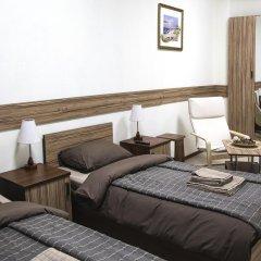Гостиница ИЛАРОТЕЛЬ Стандартный номер с 2 отдельными кроватями (общая ванная комната)