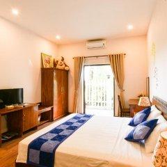 Отель Tra Que Riverside Homestay 2* Улучшенный номер с различными типами кроватей фото 2