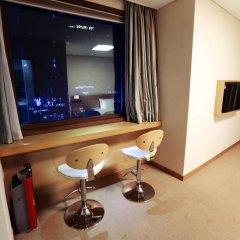 New Kukje Hotel удобства в номере
