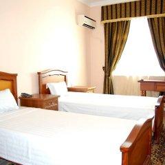 Отель Crown Tashkent Стандартный номер с 2 отдельными кроватями фото 2