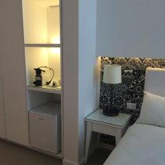 Отель Metropolitan Suites 4* Номер Делюкс фото 8