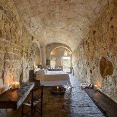 Отель Sextantio Le Grotte Della Civita 4* Улучшенный номер фото 6