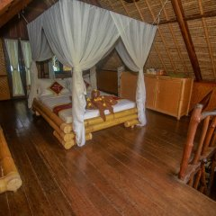 Отель Balangan Sea View Bungalow 3* Стандартный семейный номер с двуспальной кроватью фото 4