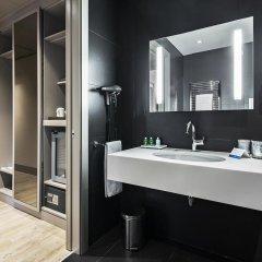 Отель NH Milano Touring 4* Улучшенный номер разные типы кроватей фото 32