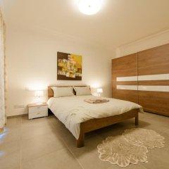 Отель Seafront Apartment Sliema Мальта, Слима - отзывы, цены и фото номеров - забронировать отель Seafront Apartment Sliema онлайн комната для гостей фото 2