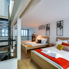 Апартаменты Sweet Inn Apartments - Rue Tardieu Париж комната для гостей фото 4