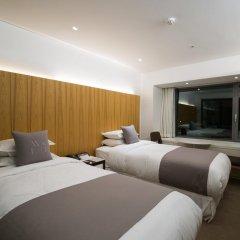 Отель Sheraton Grande Walkerhill Стандартный номер с 2 отдельными кроватями фото 11