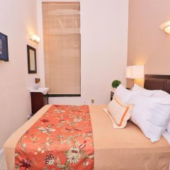 Отель Americana Inn 2* Стандартный номер с двуспальной кроватью (общая ванная комната) фото 7