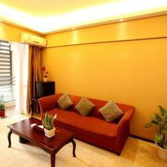 Апартаменты Jietai Xingzheng Apartment комната для гостей фото 2