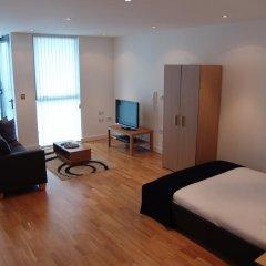 Апартаменты Quay Apartments Солфорд комната для гостей фото 4