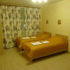 Апартаменты ComfortExpo Apartments комната для гостей