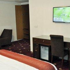 Отель Caledonian Suites удобства в номере