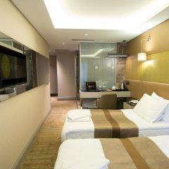 Отель GK Regency Suites 4* Номер Бизнес с различными типами кроватей фото 2