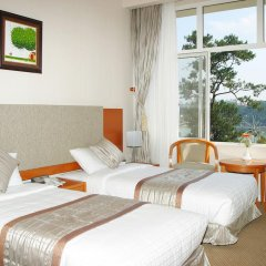 Отель Muong Thanh Da Lat 3* Улучшенный номер с различными типами кроватей фото 3