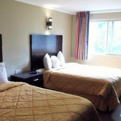 Отель Downtown Value Inn Стандартный номер с различными типами кроватей