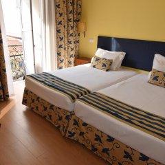 Отель Pensão Flor da Baixa комната для гостей фото 3