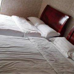 Отель Huanxi Inn Стандартный номер с различными типами кроватей фото 5
