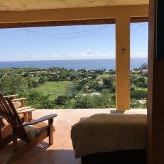 Отель Welcoming vibes Ямайка, Треже-Бич - отзывы, цены и фото номеров - забронировать отель Welcoming vibes онлайн балкон