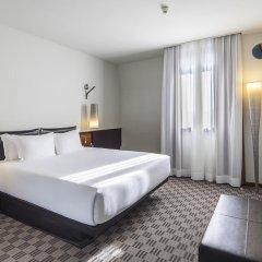 Отель NH Milano Touring 4* Улучшенный номер разные типы кроватей фото 25