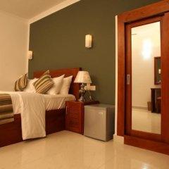 Hotel Travellers Nest сейф в номере