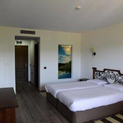 Отель Sinabovite Houses Болгария, Боженци - отзывы, цены и фото номеров - забронировать отель Sinabovite Houses онлайн комната для гостей