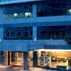 Отель Novotel Shenzhen Watergate Китай, Шэньчжэнь - отзывы, цены и фото номеров - забронировать отель Novotel Shenzhen Watergate онлайн вид на фасад фото 2