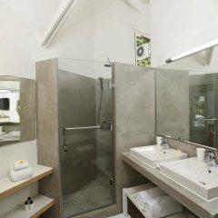 Отель La Pirogue A Sun Resort ванная фото 2
