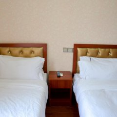 Отель Biden Shidi Holiday Manor / Xiamen Wanhe Manor Китай, Сямынь - отзывы, цены и фото номеров - забронировать отель Biden Shidi Holiday Manor / Xiamen Wanhe Manor онлайн комната для гостей фото 4