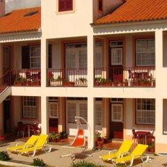 Отель Apartamentos São João бассейн