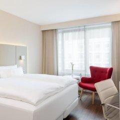 Отель NH Collection Frankfurt City 4* Номер категории Премиум с различными типами кроватей фото 5