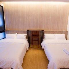 Отель Glur Bangkok Номер Делюкс двуспальная кровать фото 7