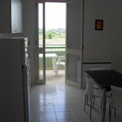 Отель Bilocali Baia Verde в номере