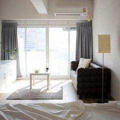 Апартаменты New Apg Apartments Бангкок комната для гостей фото 5