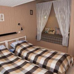 Гостевой дом У пруда Апартаменты с 2 отдельными кроватями фото 22