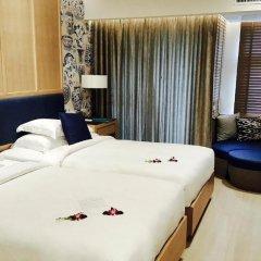 Отель Manathai Surin Phuket 4* Номер Делюкс двуспальная кровать фото 11