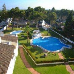 Отель Chalets Con Piscina Испания, Пуэрто Де Санта Мария - отзывы, цены и фото номеров - забронировать отель Chalets Con Piscina онлайн бассейн