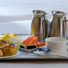 Отель NH Milano Touring 4* Стандартный номер разные типы кроватей фото 24