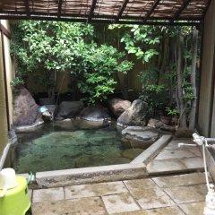 Отель Onsenkaku Япония, Беппу - отзывы, цены и фото номеров - забронировать отель Onsenkaku онлайн бассейн фото 2